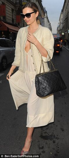 Miranda Kerr.. low-cut cream dress.. Chanel jacket.. Chanel handbag.. shopping at Chanel in Paris..