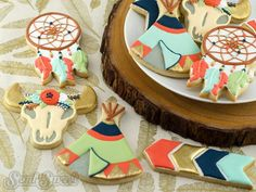 Boho decorated cookies. Here's a link on where to purchase a teepee, arrows, dreamcatcher, and cow skull cookie cutters. Also, free design templates to help decorate them in a boho/tribal/Native American style!