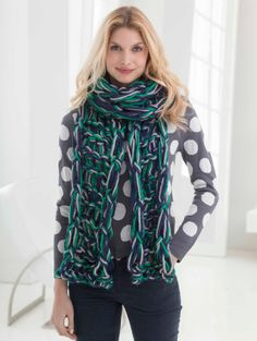 Get ready for the big game or cheer on your favorite team with this beautiful arm-knit scarf inspired by the Seattle Seahawks' team colors.