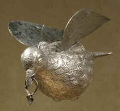 The Attarouthi Treasure - Silver Dove, late 6th–early 7th century. The dove, with wings spread and feet tucked up as if in flight, represents the Holy Spirit that appeared over the head of Christ as he was baptized by Saint John the Forerunner. Originally a small cross hung from the loop in its beak. Byzantine.
