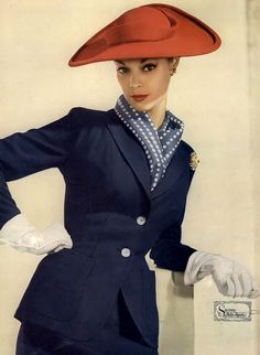 1952 Jean Patchett in classic two-button suit of Palm Beach cloth by Sacony.