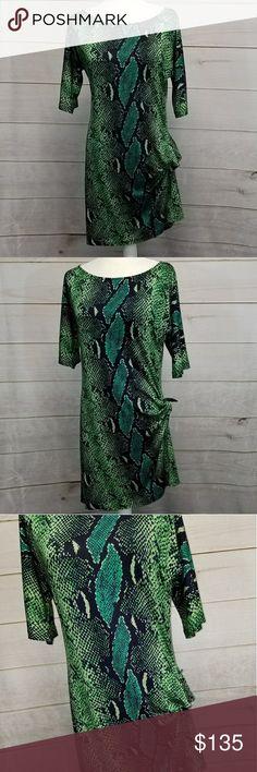 Diane Von Furstenberg Green Dress 8 EUC  Diane Von Furstenberg  Green snake skin look dress 100% silk Size 8 Green blue Size tie at the bottom Diane Von Furstenberg Dresses