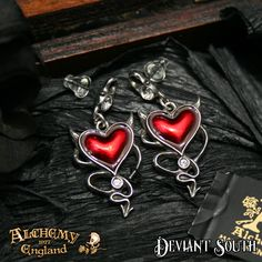 Best Seller! Alchemy Gothic ULFE22 Devil Heart Stud Earrings (pair)  A pair of crystallised pewter studs with surgical steel ear posts and with pendants featuring a translucent red enamelled 3D heart.