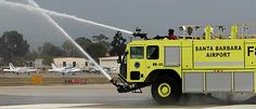 Water sprayers underneath Santa Barbara Airport Fire Truck F81 protect it as it approaches fires.