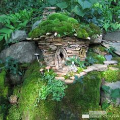 Fairy Door & Entry Garden Stone Faerie Hut by Sally J. Smith -- A wee garden hut for the faeries made of sandstone with willow twig windows & a moss roof w/ stepping stones leading along a mossy cliff. Garden Huts, Fairy Garden Houses, Gnome Garden, Diy Garden, Fairy Doors, Stone Houses, Stone Cottages, Green Art, Garden Stones