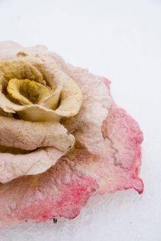 Rose brooch from wool and silk