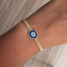 The product Bracelet Œil Turc or is sold by Laaly Créations in our Tictail store. Tictail lets you create aTriangle Pendant 3 D Miyuki beads, black, white, gold Seed Bead Jewelry, Diy Jewelry, Beaded Jewelry, Handmade Jewelry, Jewelry Design, Jewelry Making, Bead Loom Patterns, Bracelet Patterns, Beading Patterns