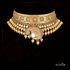 If the South echoes tradition, North celebrates heirloom. This  holds the ancient gold foil art of Kundan  with modern tweaks to increase your glamour quotient, perfected by the master craftsmen at   Wedding Jewellery Inspiration, Indian Wedding Jewelry, Indian Jewelry, Indian Bridal, Bridal Necklace, Bridal Jewelry, Gold Necklace, Jewelry Necklaces, Real Gold Jewelry