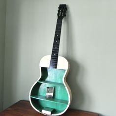 Use old junk guitar to make wall shelves. Kyle could use these in a music room.
