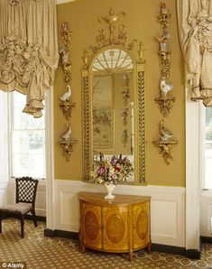 It contains a large collection of 18th century furniture, porcelain and textiles