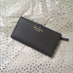 Kate spade Stacy cobble hill waller in color storm Brand new, slim profile dark gray leather authentic kate spade wallet. kate spade Bags Wallets