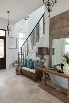 Beach Style Entry Decorating ideas with beige floor tile blue