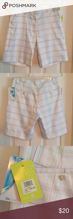 """White plaid golf shorts with red, blue, and green White plaid golf shorts with red, blue, green, black, and gray lines. Lightweight moisture wicking material. Great for a sunny day out on the golf course. Goes with a variety of different colors. Approximately 20"""" long from top of waistband to hem of pant, with approximately 10"""" inseam Aspire Shorts Bermudas"""