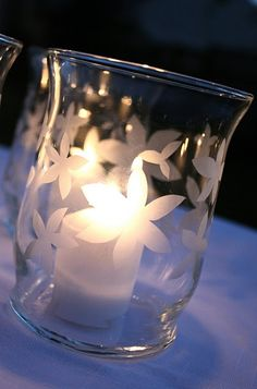 etched votives could also be pretty in case you don't find enough jars...although, the doily thing on the plain glass is also an option @Gianna Maria