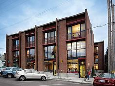 Eight live-work lofts with rooftop decks are a fresh take on urban renewal in Seattle's Columbia City neighborhood.