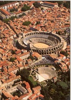 """AMPHITHEATER OF ARLES, Provence-Alps-Cote d'Azur, Arles, France - """"Arles boasts a very well preserved Roman arena and theatre where performances take place all summer. It is the capital of Camargue."""" The amphitheater also is famous for its bullfighting. Oh The Places You'll Go, Places To Travel, Places To Visit, Wonderful Places, Beautiful Places, Belle France, Beau Site, Provence France, Provence Style"""