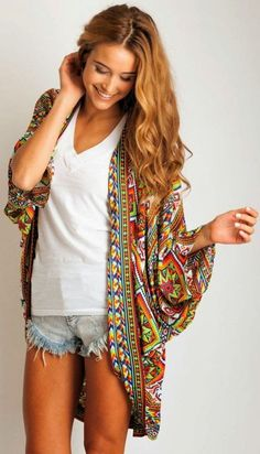 Add this to my India vacation clothes ideas!  Colorful oversized cardigan with white and denim