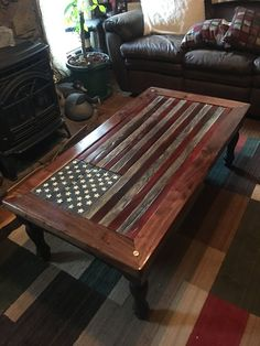 This table is handmade of solid wood and displays the American Flag on top of it. It's been finished with polyurethane. The flag is constructed of individual pieces of woods and hand painted. It is an