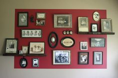 LOVE everything about this! Love the two tone color on the wall, old shelfs, frames and family photos.