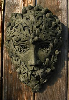 OAK OVAL GREEN MAN This piece is an elegant representation of an elfin Green Man surrounded by oak leaves. All our ornaments are made and painted by hand. Cast in frostproof casting stone the Oak Oval Green Man is suitable for both indoors and outdoors. He is 26cm wide, 34cm high, and weighs about 4kg.