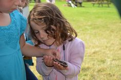 Being brave and gently holding a slow worm. Photographer: Karen Cruddis