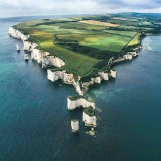 Old Harry Rocks are three chalk formations, located at Handfast Point, on the Isle of Purbeck in Dorset, southern England.