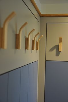 The perfect coastal cloaks solution with practical pegs & pigeonholes in this item of bespoke joinery