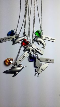 Free! Iwatobi swim club necklace Haru Makoto Rin Nagisa Rei by ToyTransformer on Etsy https://www.etsy.com/listing/258090000/free-iwatobi-swim-club-necklace-haru