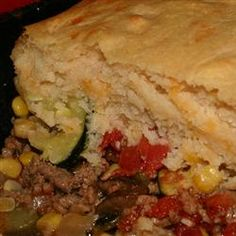 "Saucy Beef and Vegetable Casserole | ""Ground beef (or ground turkey), shredded zucchini, spices, salsa, tomato soup, and corn are cooked with a garlic, sour cream, and Cheddar cheese biscuit topping. Even my toddler loves this recipe!"""