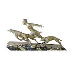 French Art Deco Running Male with Dogs on the hunt by Valderi   From a unique collection of antique and modern sculptures at http://www.1stdibs.com/furniture/more-furniture-collectibles/sculptures/