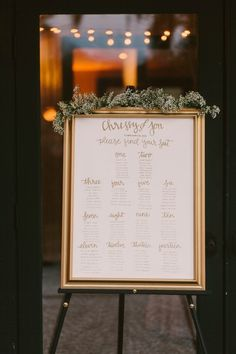 Elegant gold framed wedding seating chart  | Image by Paige Jones