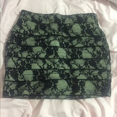 Windsor lace overlay skirt Windsor lace overlay skirt worn once. Bought this a few years ago just sitting in my closet. Can probably fit someone that wears mediums. It's a size small and was a little big on me. Black lace over beige color WINDSOR Skirts Mini
