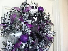 This Purple, silver, black and white Jack Skellington wreath was originally made as a custom Christmas wreath order for a customer. I have enough supplies to ma