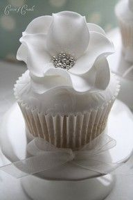 Flower cupcake ~ The flower is made with rounds of fondant, ruffled then assembled with edible glue and a touch of silver dragees to add finishing accent~