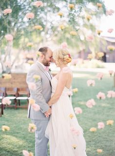 Behind hanging carnations: http://www.stylemepretty.com/2015/08/10/vintage-rustic-whispering-rose-ranch-wedding/   Photography: Sposto - http://spostophotography.com/