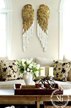 DECOR STEALS ANGEL WINGS- in the living room-stonegableblog,com