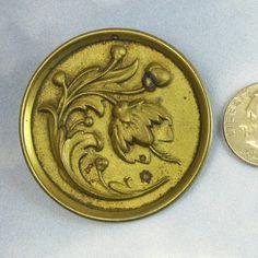 Antique Button Victorian Button Huge Ornate Cherry Floral Brass Button 86. $20.00, via Etsy.