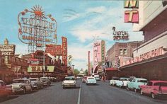 A postcard shot of downtown Las Vegas - I see a 57 Chevy so it might be right about that time