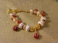 Gold is elegant on the wrist. by TwoSistersBling on Etsy