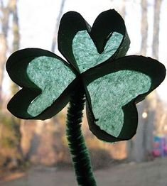 Shamrock cardboard tube craft for St. Patrick's Day.
