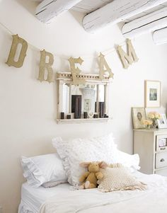 Decorating idea: Glittery letters strung above a childs bed can spell out words and names. #decoratingideas #bedrooms