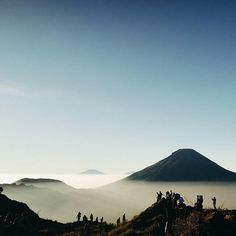 """This is a picture I took from a place called Sikunir Golden Sunrise, Wonosobo, Central Java, Indonesia. I could see tons of hills lined up beautifully, the panoramic view was indeed visually eye pleasing. What an undoubtedly breathtaking place in Java island.""""— Sikunir, Wonosobo, Central Java, Indonesia.   by @ragilson"""