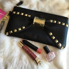 Ultra Cool Betsey Johnson Bow Wristlet Fun! Fun! Fun! You'll love this wristlet! Enough room for your essentials and your phone. Interior is fully lined with Betsey Johnson signature lips pattern, and zippered interior pocket. Ultra smooth black exterior with zippered pocket in the back. Front of the bag boasts a gorgeous black bow with gold studs, and magnetic slip pocket. Wristlet has a top zip closure and removable strap. Betsey Johnson Bags Clutches & Wristlets