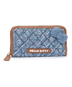 Take this trendy wallet on the go for a cute-chic flair. Its denim make is complemented by a subtle and ever-adorable Hello Kitty print, making it a functional and fashionable accessory for any occasion.