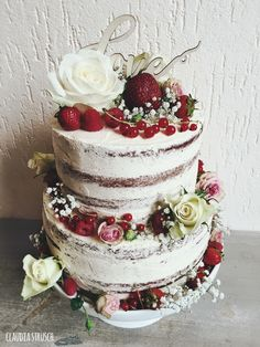 Semi Naked Wedding Cake With Fresh Berries And Flowers