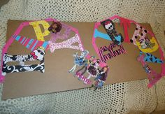 Personalized with a Dollar Store Banner, Scrapbooking paper & Monster High pictures.    https://www.facebook.com/DessertsByJessica