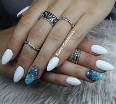 white almond nails.petrol and light blue ombre with caviar and rhinestones
