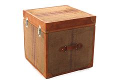 With its leather trim and natural jute accents, this trunk has a charming, heirloom appeal.