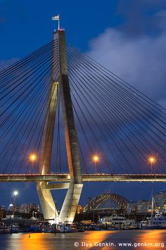 Anzac Bridge and Sydney Harbour Bridge, Sydney, Australia. The ANZAC bridge was given its current name on Remembrance Day in 1998 to honor the memory of the soldiers of the Australian and New Zealand Army Corps (ANZAC) who served in World War I. An Australian Flag flies atop the eastern pylon and a New Zealand Flag flies atop the western pylon. (V)