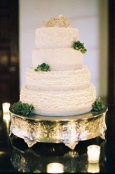 Ruffled wedding cake with succulents and bird cake toppers (Photo by Kurt Boomer)